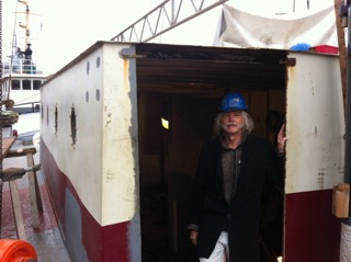 STN reporter and photographer Jan Lundberg in galley & navigation station - photo by Dexter