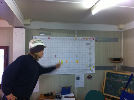 Timbercoast's Dexter points out scheduling details - photo Jan Lundberg